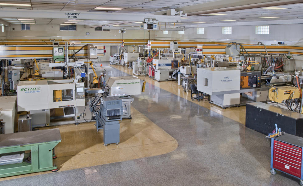 AAE's 8,400 sq. ft. Pressroom. Inset: AAE's 500 ton Toshiba molding machine is equipped with an automated 3-axis robot for quick part removal and faster cycle times. We have two different barrel sizes allowing us to effectively mold parts from 8 oz. to 6